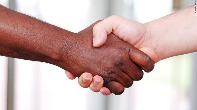 171114091710-black-white-handshake-stock-exlarge-169