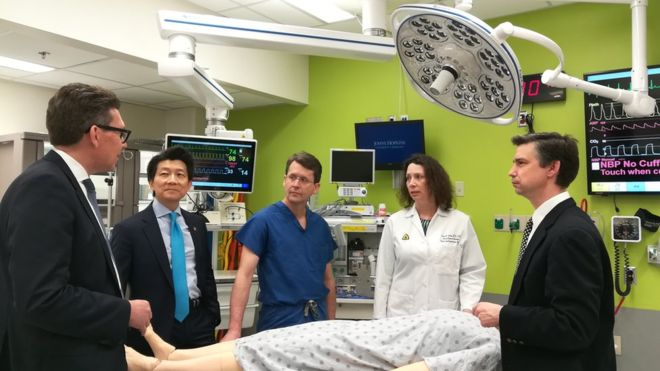 Dr Andrew Lee and other members of the surgical team